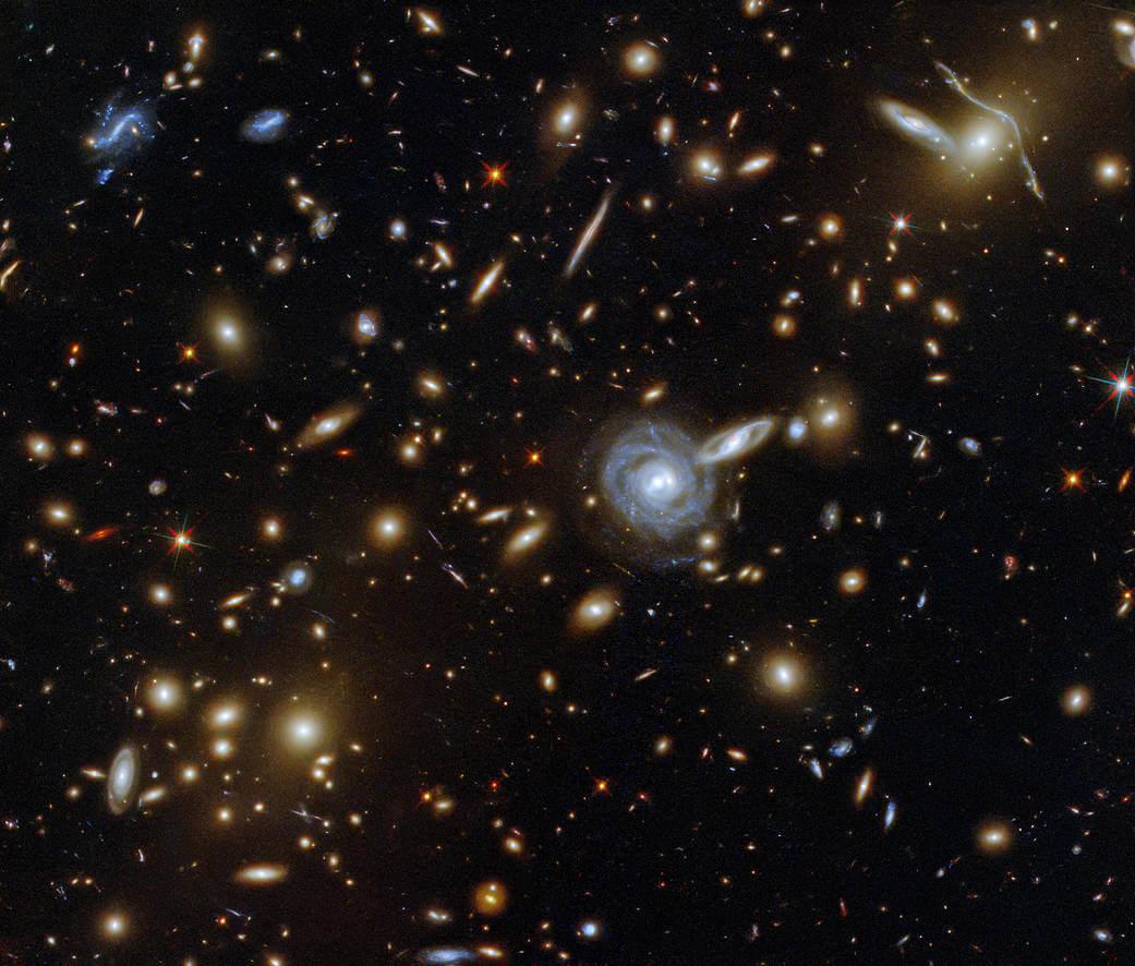 Da je naša galaksija le ena od mnogih v vesolju priča tale posnetek majhnega koščka neba, ki so ga posneli z vesoljskim teleskopom Hubble. Po diagonali slika meri le 3,4 ločne minute, kar je le ena desetina navideznega premera polne lune. Na njem se »drenja« okoli 10.000 galaksij vse do roba vidnega vesolja. Foto: NASA\ESA\ G. Illingworth, D. Magee in P. Oesch (University of California, Santa Cruz)\R. Bouwens (Leiden University)\HUDF09 Team